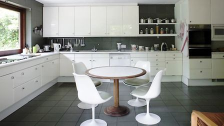 The architect's round table and chairs in the sleek kitchen