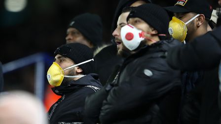 Fans wear face masks during the FA Cup Fifth Round match between Leicester City and Birmingham City