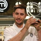 Mark Stinchcombe lifts the MasterChef: The Professionals trophy.