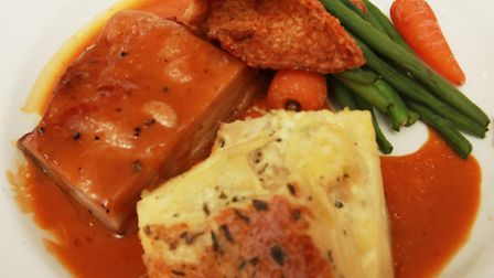 Slow roast belly of pork with dauphinoise potatoes and brandy cream sauce