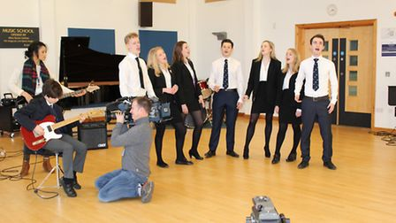 The One Show films Reigate Grammar School pupils performing My Coo Ca Choo in the school's music bui