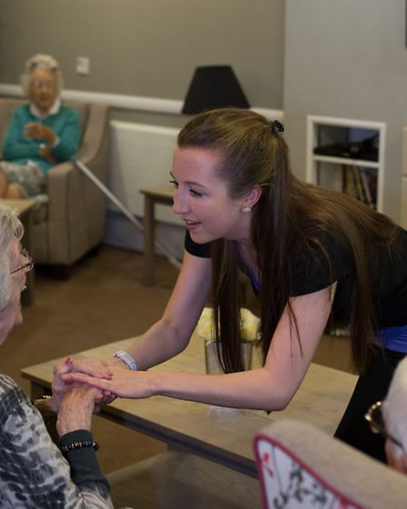 Lucy interacting with a participant at a Musical Moments session