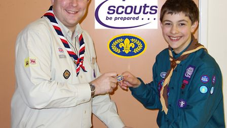 Kieran Twaites recieving his Chief Scout Gold Award from the District Scout Leader.