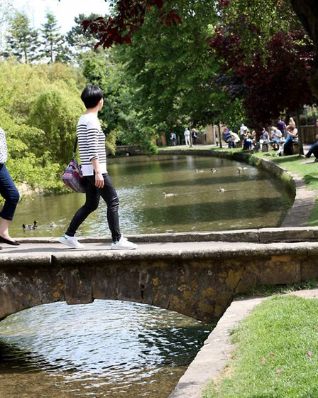 Crossing the tiny bridges is part of the Bourton experience
