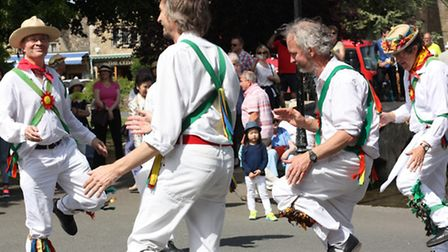 The Morris dancers throw shapes navigating around a tiny, bemused observer
