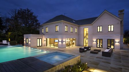 The rear of Newlands House has a large swimming pool, spa and dining area