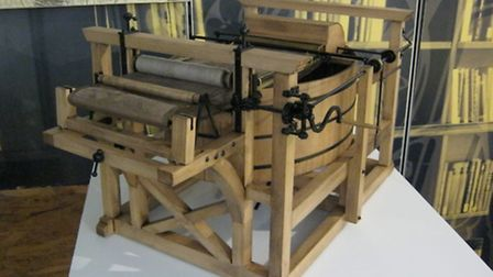 A scale model of a hand-driven single vat paper press of the kind used before mechanisation
