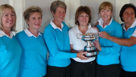 The team are pictured with the Percival Trophy