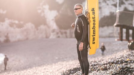 Open water swimmer Neil Tubbs with the Swimboat
