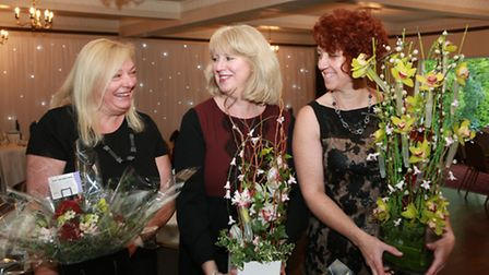 Amanda Hamblyn, Carolyn McCurrie and Ann Gater arrive with a floral consignment