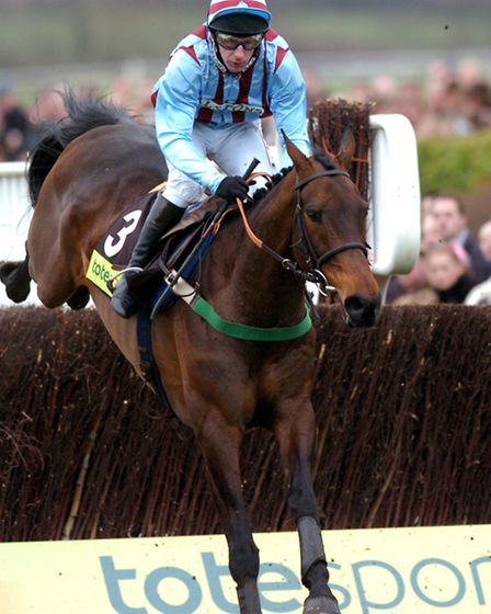 Best Mate riden by Jim Culloty on their way to their third consecutive Cheltenham Gold cup victory