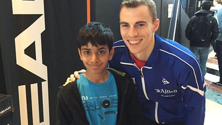 Yusuf with Nick Matthew, former world number one squash player