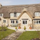 This fairytale cottage has benefited from having a much bigger and more substantial porch built on,