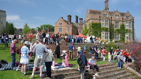 Costumed runners and onlookers enjoy the sunshine in May 2013, when the first Chilham Chase was held