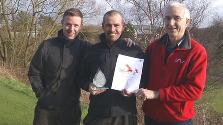 Eddie (centre) with his award flanked by Victor Tarr and assistant green keeper Wayne Atkinson