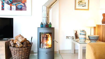 Woodburners using sustainably-sourced fuel are one of the heating sources keeping the house energy s