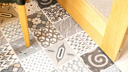 Mixed monochrome tiles add character to the dining area