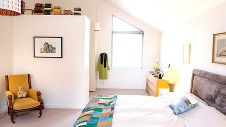 The master bedroom - splashes of colour stand out against the contemporary white walls