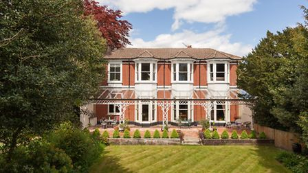 This Victorian villa features attractive bay windows and verandah and overlooks private south-facing