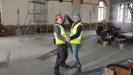 Strictly fun.....Workmen Shaun Pugh and Johnathan Key imagine the scene when the Village Point proje