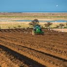 Tractors carrying out deep bed shaping followed by sowing the fields in early springs time at Burnha