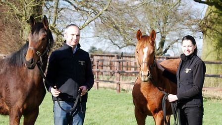Max Weston with yard manager Shelley Brinkworth. Max is holding a yearling filly sired by Sea The St