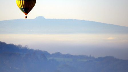 A Balloon flies over Fog covering Gloucester, with May Hill in the background © Paul Nicholls, www.p