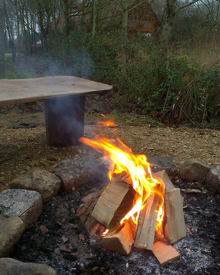 Fire pit with Kaiser's Kabin in the background