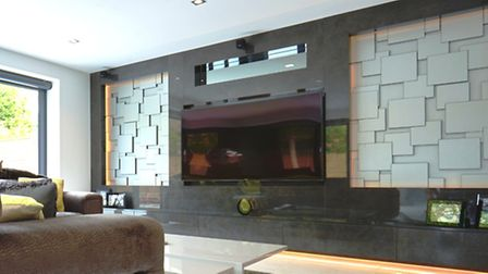 Garden room with media wall, incorporating unique panelling