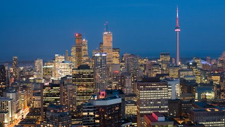 A view over Toronto with the famous CN Tower just visible in the distance (Photo Ontario Tourism)