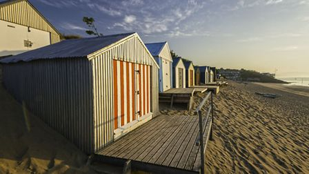 Beach huts at Abersoch. Crown copyright. Visit Wales.