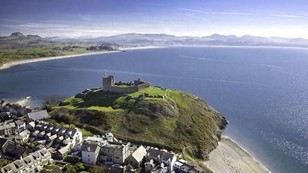 Criccieth castle, standing between the resort's two beaches. Crown copyright. Visit Wales.