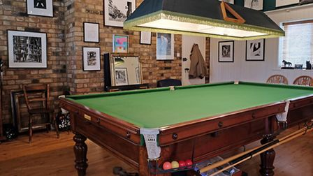 The games room with snooker table created for the Jones' children (Photo: Danny Loo)