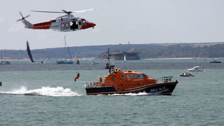 Bembridge's ALB Alfred Albert Williams assists a coastguard helicopter in a winching display at the