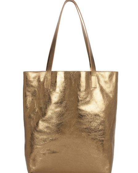 This gold metallic leather shopper, £135, is perfect for all your poolside essentials, by Sarah Bail