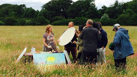 Yvonne Coomber (left) and Countryfile presenter Naomi Wilkinson (right) painting a canvas. Photo by: Mike Boyer