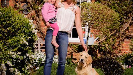 Roxy, 2, with mother Niki Perry and dog Jester outside Hatchers in Sidlesham Common.Picture by Jim