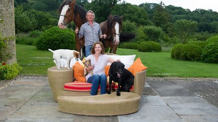Martin Clunes with his wife Philippa and two of their horses