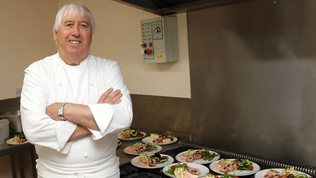 Trevor Stone with dishes for the lunch