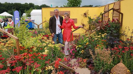 Designer, Andy Walker, and BBC North West Tonight's Dianne Oxberry in the NSPCC 'Melitta' garden fo