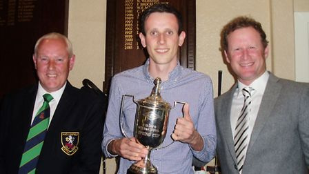 Gareth Robinson receives the trophy The Spring Cup from Captain Neil Jackson and sponsor Jamie Donal