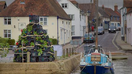 The lobster pot Xmas tree on the quayside with Peter's boat, Sarah C, alongside (Photo by John Twedd