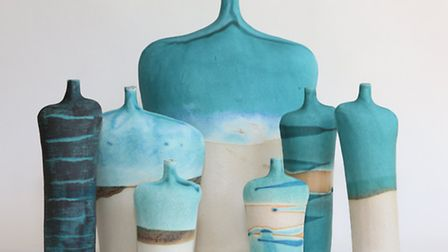 Selection of hand built slab bottles, reminiscent of figures with colours that evoke the feeling of