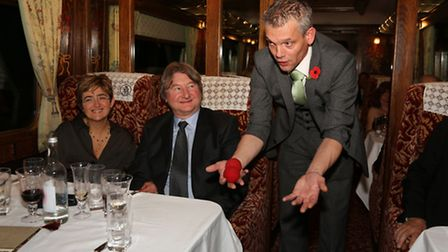 Magician, Mr Lido performs in front of Sibel and Gill Rutherford aboard a Northern Belle excursion f