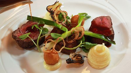 Slow braised short rib and roast fillet of beef with textures of onion, pomme dauphine and Wirral wa