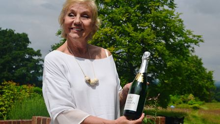 Sibylla with a bottle of High Clandon's Quintessence (Photo: Matthew Williams)