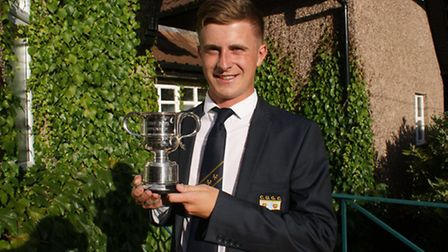 Rhys Nevin-Wharton with the Cheshire Boys Championship trophy