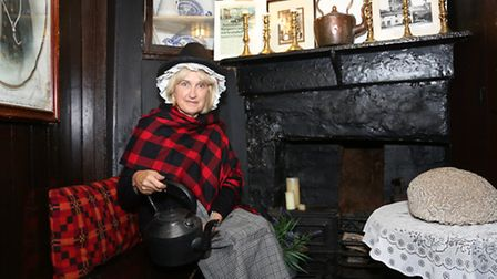 Anne Fletcher, guide at the smallest house in Great Britain