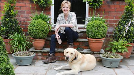 Winifred Robinson with dog, William, at her Stockton Heath home