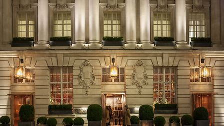 Courtyard entrance to Rosewood London with country-gent doormen